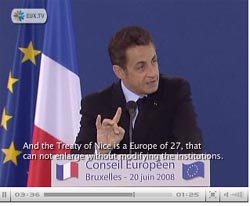 Nicolas Sarkozy hands are purposeful set to show the devils horns