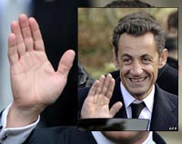 Nicolas Sarkozy hands are purposeful and held to make points